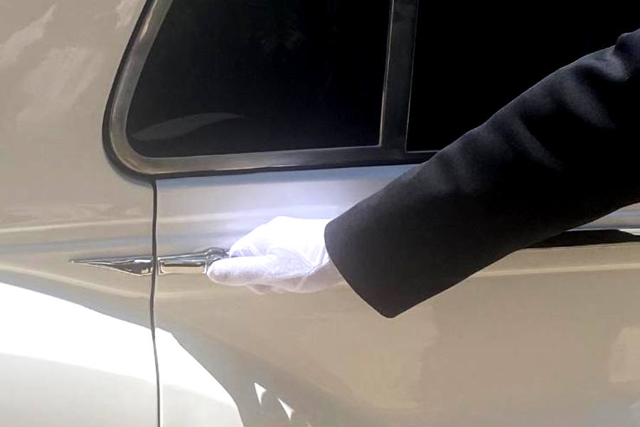 limo driver opening door with gloved hand